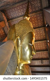 BANGKOK, THAILAND - JULY 30, 2019: Giant Buddha statue and the worship, praying place at Wat Pho, the Temple of Reclining Buddha