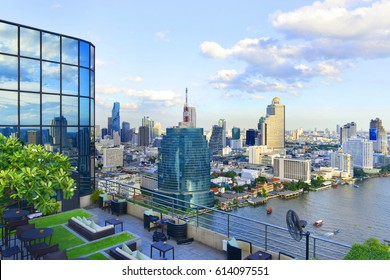 BANGKOK, THAILAND, JULY 31, 2016: Restaurant couch bar with view of Bangkok Cityscape at the Three Sixty Lounge of Millennium Hilton Bangkok Hotel in Bangkok, Thailand