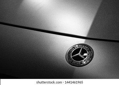 Bangkok, Thailand - July 4, 2019: Mercedes benz logo on the car. Close up of Mercedes benz metal logotype on the silver car background. The German brand is known for luxury vehicles.