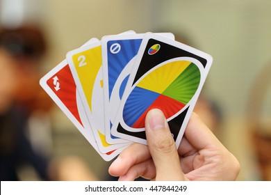 BANGKOK, THAILAND - JULY 5, 2016: Uno card game on a hand on July 5,2016 in Bangkok Thailand.