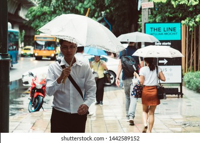 Bangkok, Thailand - July 5, 2019 : Unidentified man holding the umbrella, monsoon season, raining in Bangkok, Thailand.