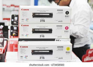 BANGKOK, THAILAND- JULY  6, 2017 :  Ink display at a local retail location in Thailand. Canon toner Cartridges and Ink Supplies,Original Canon cartridge 316 use for Printer Model LBP LBP 5050 Black
