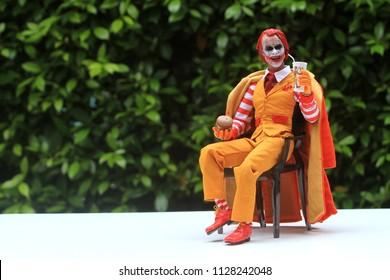 BANGKOK THAILAND - JULY 6 ,2018 : Close up shot of Joker wearing a McDonald's uniform figure in action at home in Bangkok, Thailand