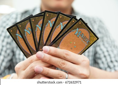 BANGKOK, THAILAND - JULY 6: The Land cards of game Magic: The Gathering on Player Hand on July 6,2017.