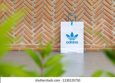 BANGKOK, THAILAND - JULY 7, 2018: Paper bag Adidas original logo for product Adidas original. Adidas - German industrial group specializing in the production of athletic footwear, apparel.