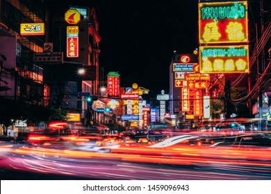 Bangkok, Thailand - July 7, 2019: Colorful signs and the light trails from cars moving on the night of Yaowarat Road at main street in Bangkok's Chinatown