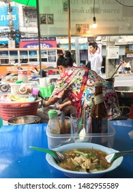 Bangkok, Thailand - July 7, 2019: A scene of eating a bowl of traditional Thai-Chinese fish maw soup in rich thick stock served with mushrooms and crab meat background with the woman seller. - Image