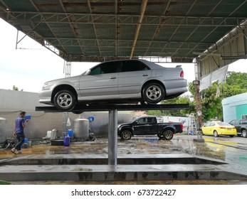BANGKOK, THAILAND - JUlY 8, 2017 : Car up the lift to wash under the car.