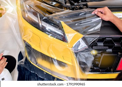 BANGKOK, THAILAND - JULY 8, 2020: Paint protection film attached to front panel of Audi TT. PPF is polyurethane film that help protect paint from scratch. Selective fous & shallow DOF.