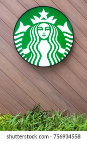 Bangkok, Thailand - July 9, 2017: Starbucks coffee Logo brand on a diagonal wooden wall panel with copyspace. Starbucks is the largest coffeehouse company in the world.