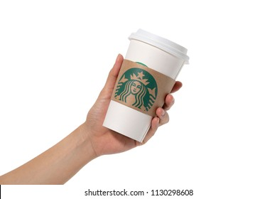 Bangkok, Thailand - July 9, 2018: Female hands holding a cup of Starbuck coffee on white background