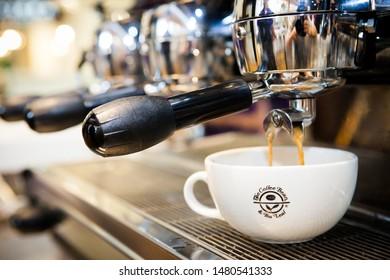 Bangkok , THAILAND- July-27-2019 : Coffee. Coffee espresso.Espresso machine brewing a coffee double shot  with beautiful crema.