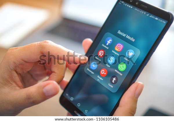 Bangkok, Thailand - JUN 06, 2018: Coronavirus prevention by work from home with Smartphone social medial. Mobile phone