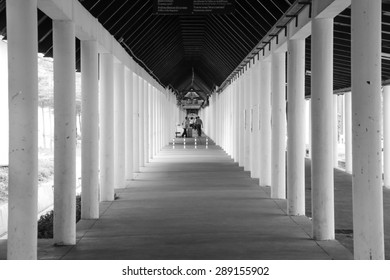 BANGKOK, THAILAND - JUN 15, 2015 : Black and White effect, Hallway in the university at Bangkok, Thailand on Jun 15, 2015. The security officers are on duty to patrol and guard for student safety.