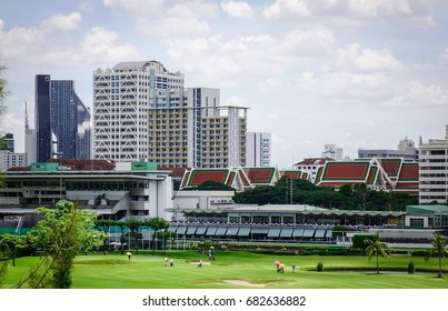 Bangkok, Thailand - Jun 17, 2017. View of a golf course with pagodas at sunny day in Bangkok, Thailand. Bangkok is a large city known for ornate shrines and vibrant street life.