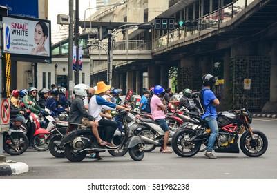 BANGKOK, THAILAND - JUN 18, 2016. Many scooters on street in Bangkok, Thailand. Annually an estimated 150,000 new cars join the already heavily congested streets of Bangkok.