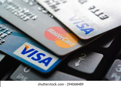 Bangkok, Thailand - Jun 23, 2015 : Group of credit cards on computer keyboard with VISA and MasterCard brand logos