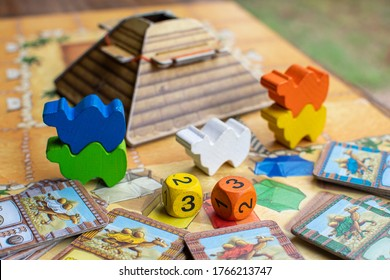 """BANGKOK, THAILAND, JUN 26, 2020 : Colorful component of board game called """"Camel up"""" Camel up is camel racing competition take place in egypt, in each turn players bet which camel become a champion"""