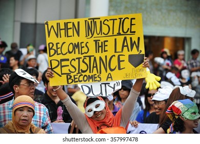 BANGKOK, THAILAND - JUN 30, 2013: A protester holds up a sign with a Thomas Jefferson quote at a large anti government rally in the Thai capital's shopping district. The protesters call for a coup.