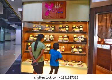 Bangkok / Thailand - Jun 6 , 2018 : Mom and daughter see the menu at front of restaurant (Yayoi hot quick Japanese restaurant by MK).