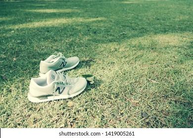 Bangkok Thailand Jun 8 2019 - New Balance sports shoes on green grass at the park