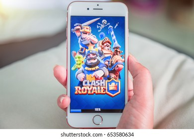 Bangkok, Thailand - June 03, 2017: Hand hold and start loading Clash Royale on an iPhone 6s running iOS. Clash Royale is a popular online game in iPad/iPhone/iPod/Android game created by Supercell.