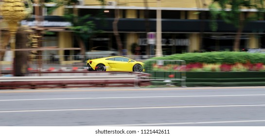 Bangkok, Thailand -  June 03 , 2018: yellow Lamborghini Gallardo driving very fast on the street. motion blur.