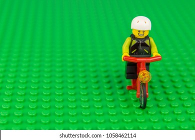 BANGKOK, THAILAND JUNE 05, 2017 : Studio shot of LEGO that riding bicycles on green background
