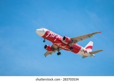BANGKOK, THAILAND - JUNE 1, 2015: HS-ABR Airbus A320-216 of Thai Air Asia landing to Don Mueang International Airport Thailand. Thai Air Asia company is the largest low cost airlines in Asia.