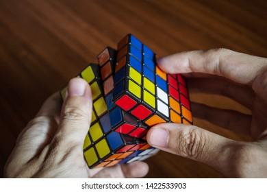 Bangkok, Thailand - June 10, 2019 : People solving Rubik's cube