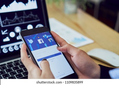 Bangkok, Thailand - June 11, 2018 : hand is pressing the Facebook screen on apple iphone6 ,Social media are using for information sharing and networking.