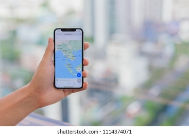 Bangkok, Thailand - June 12 2018: Close up a man hand hold iphone X open website google map for checking map and location. To checking map and location from internet.