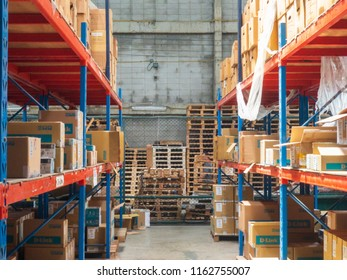 BANGKOK, THAILAND - June 12: Sukumvit Distribution center warehouse on June 12,2018 in Bangkok, Thailand. Many Cardboard boxes of products placed on Large shelves for distribute to clients.