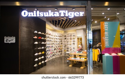 BANGKOK, THAILAND - JUNE 14, 2017 : Exterior view of Onitsuka Tiger Shop in Bangkok, Thailand. Onitsuka Tiger is one of the oldest shoe companies in Japan.