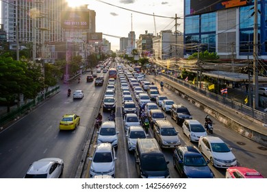 Bangkok, Thailand - June 14, 2019: Traffic jam moves slowly along a busy road in city center in Bangkok. Annually an estimated 150,000 new cars join the heavily congested streets of the Thai capital.