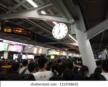 BANGKOK, THAILAND - JUNE 15, 2018: People standing in lines waiting for BTS sky train station in rush hour in Bangkok Thailand.