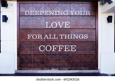 Bangkok, THAILAND - June 16, 2017: Starbucks slogan on the wood wall at Tha Maharaj. Starbucks Corporation is an American coffee company and coffeehouse chain