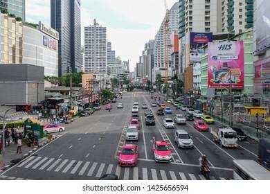 Bangkok, Thailand - June 16 2019: Landmark Asoke-Sukhumvit intersection traffic conditions on morning weekend.