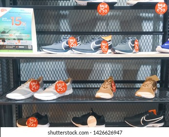 Bangkok, Thailand - June 16, 2019: Nike running shoes sale 10-35% promotion price discount, and receive an additional 15% discount if have participating credit card, At Nike store in shopping mall.