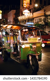Bangkok, Thailand - June 16,2019 : Famous moto-taxi called tuk-tuk is a landmark of the city and popular transport, Tuk tuk on the street in Chinatown, street food night market in bangkok thailand.