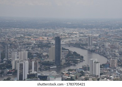 BANGKOK, THAILAND - JUNE 16,2020: The Bangkok cityspace viewing from the rooftop floor of Mahanakorn building on bad weather day, Bangkok