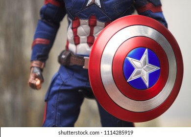 BANGKOK THAILAND - JUNE 17 ,2018 : Close up shot of Shield for Captain America Civil War superheros figure in action fighting. Captain america appearing in American comic books by Marvel.
