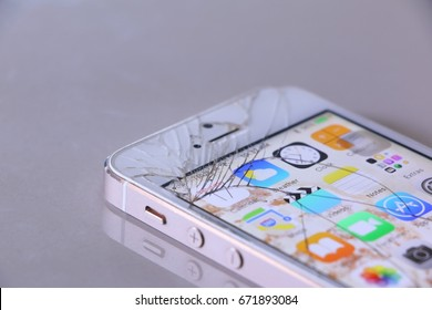 Bangkok, Thailand - June 17: Studio shot of  an iPhone 5s with seriously broken retina display screen  on white on June 17, 2017. iPhone 5s is a smartphone developed by Apple Inc.