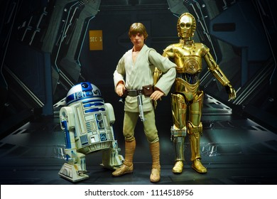Bangkok, Thailand- June 17,2018: Luke Skywalker with his robots R2D2 and C3PO, an action figures from Star Wars