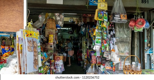 Bangkok, Thailand - June 17th 2018 :  a young woman buying some consumer goods in old grocer's street shop.