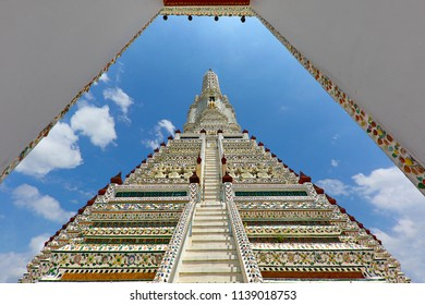 BANGKOK, THAILAND - JUNE 18, 2018: View over Wat Arun Temple through the gate inside, in Bangkok, Thailand.