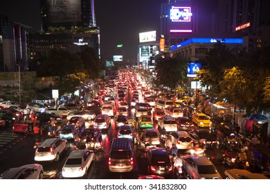 BANGKOK, THAILAND - JUNE 19, 2015: Crowd of vehicles stand in a traffic jam after raining in the evening.