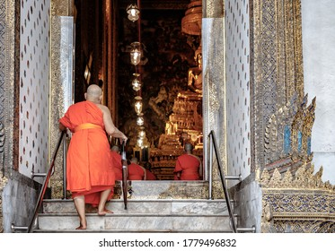 BANGKOK, THAILAND - JUNE 1st 2018 : Buddhist monk on his way to the daily prayer in one temple of the grand palace from Bangkok