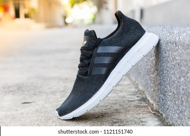 BANGKOK, THAILAND - JUNE 2, 2018: Adidas swift run w black color 2018 sports shoes for running for women on street - illustrative editorial