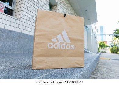BANGKOK, THAILAND - JUNE 2, 2018:Paper bag Adidas, Adidas AG headquartered in Herzogenaurach, Bavaria, Germany is the largest sportswear manufacturer in Europe and the second biggest in the world